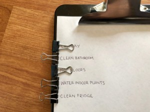 A clipboard with binder clips on the side to mark a to-do list.