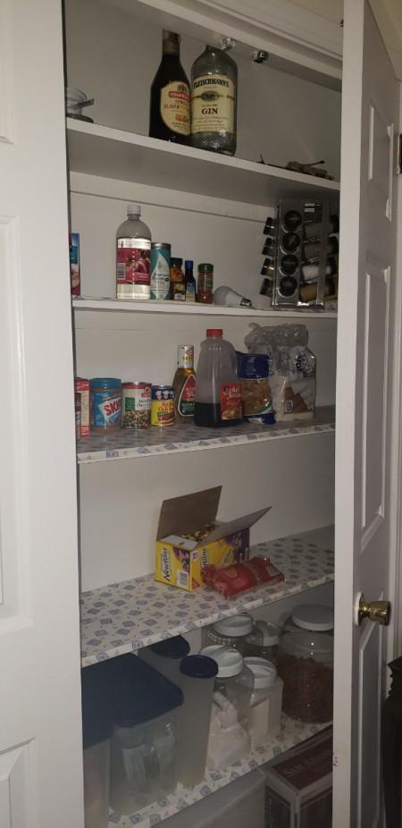 A disorganized pantry shelf.