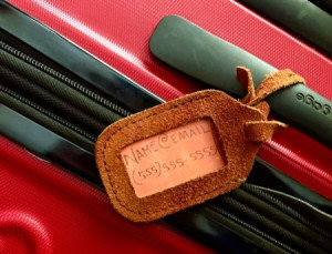 A luggage tag with just the person's email and telephone number listed.
