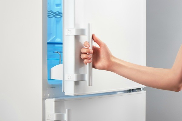 Hand Opening A Freezer Door.