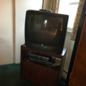 A television in the corner of a room.