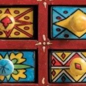 Brightly painted small drawers.