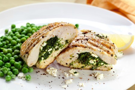 Feta Stuffed Chicken Breasts with aside of peas.