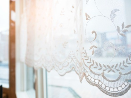 Lace curtains on a window.