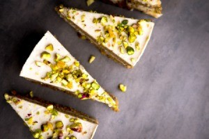 Pistachio Cake on a grey surface.