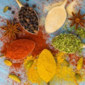 A selection of different spices, both powdered and whole.