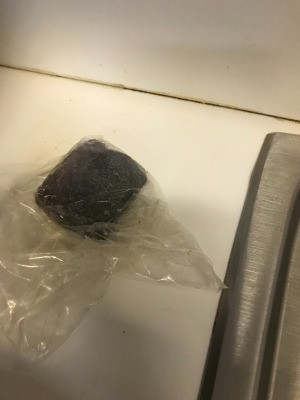A brillo pad stored inside a sandwich bag.
