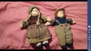 Identifying Porcelain Dolls - dolls lying on a comforter