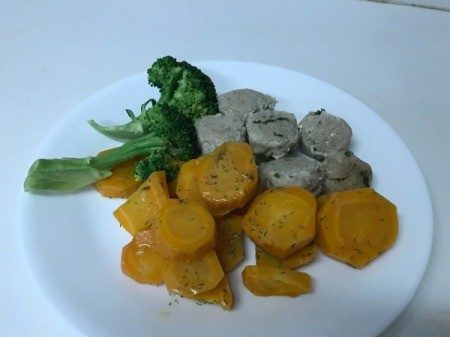 Dilled Carrots with broccohli and sausage on dinner plate