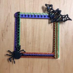 Halloween Seasonal Frame - finished frame with a black bat also glued on the upper corner opposite the spider