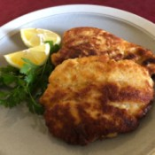 Chicken Schnitzel on plate with lemon bridges