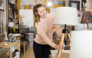 Woman looking at a lamp in a store.