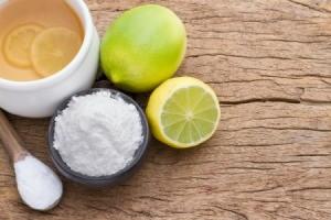 Lemons, lemon powder and a cup of lemonade