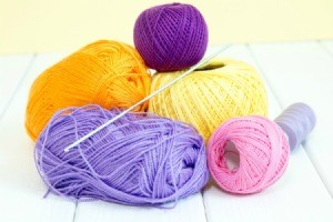 Pile of thin yarn in different colors.