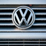 Close up of a VW emblem on a car grill.