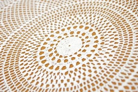Closeup of crochet tablecloth.