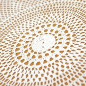 Closeup of crochet tablecloth.