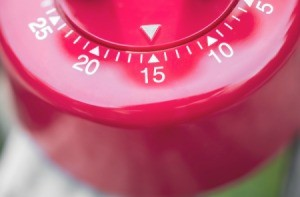 Close up of a red timer set to 15 minutes.