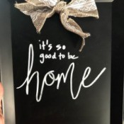 A decorative chalkboard with a bow.