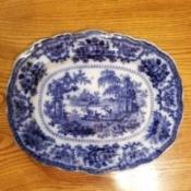Value of an Antique Flow Blue Plate - platter