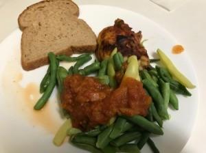 Tomato Sauce on string beans on dinner plate