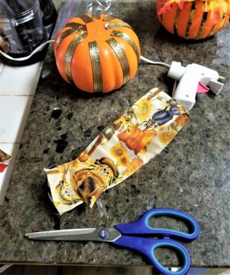 Embellish a Dollar Tree Pumpkin - cut ribbon and glue to pumpkin
