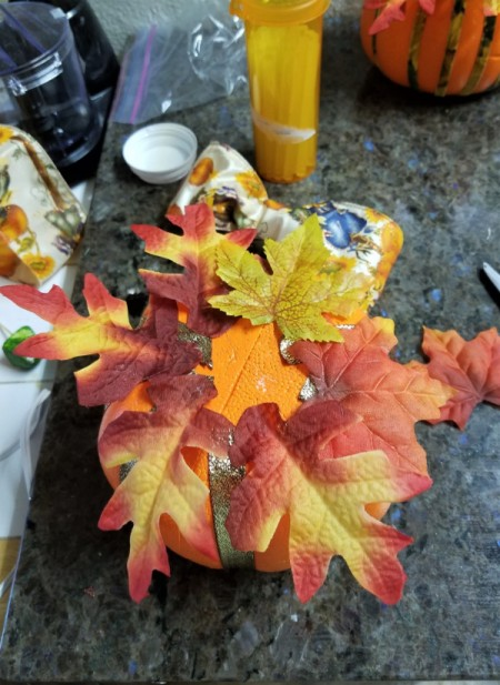 Embellish a Dollar Tree Pumpkin - glue or pin the leaves in place