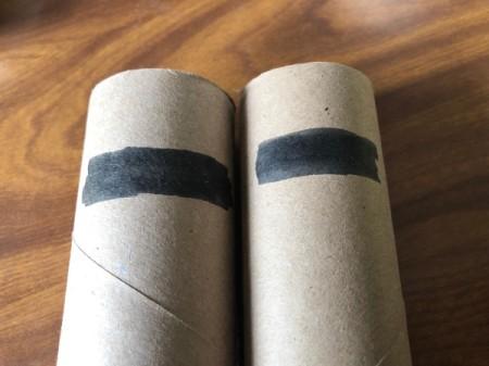 Fun Halloween Bathroom Decor - draw a black rectangle near the top of two TP rolls