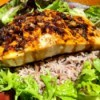 Sweet and Spicy Salmonon bed of rice with lettuce