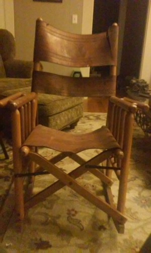 Value of a Folding Rocking Chair - embossed  leather and wood folding rocker