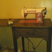 Value of a Morse Sewing Machine - machine in cabinet
