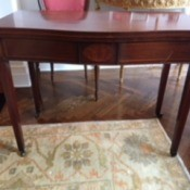 Value of a Brandt Table - vintage mahogany table with small casters on legs