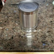 Cans Can Do So Many Things - larger can inverted over the smaller one