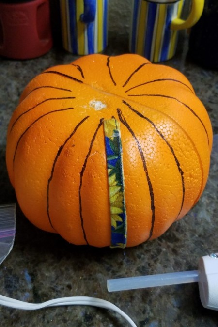 Not Country Bumpkin - Country Pumpkin! - covering marker lines with fabric strips