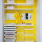 Yellow closed with drawers and shelves.