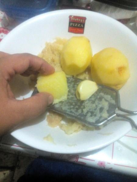 grating potatoes and garlic
