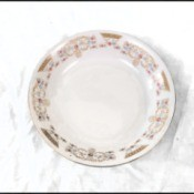 Value of 16 Serving China - dinner plate with a floral pattern around the edge