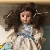 Identifying a Porcelain Doll - doll with dark brown curly pigtails and white dress with lace