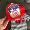 A fire fighter hat next to a fire truck themed t-shirt.