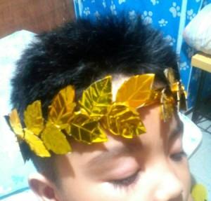 Laurel Leaf Headdress - child wearing the laurel leaf headdress