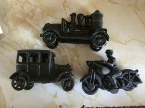 Value of Cast Iron Vehicles - motorcycle, car, and steam driven vehicle
