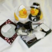 A variety of wedding favors, including a bride and groom rubber ducky.