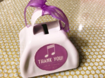 "A small weddding favor shaped like a bag that says ""thank you"""