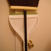 Adjusting a Dust Pan Clamp - broom and attached pan hanging