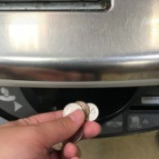 Using coins at the self check out line at the grocery store.
