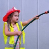 little girl dresses as a firefighter
