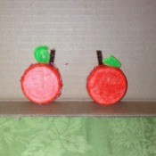 Milk Lid Pumpkin Magnets  - two finished pumpkin magnets