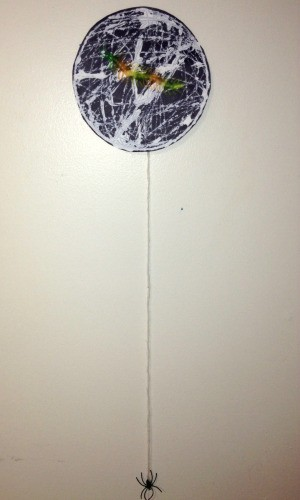 Marble Painted Paper Spider Web - long dangling strand of yarn with spider hanging below the web