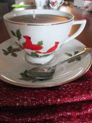 Using Leftover Candle Wax For Gifts - tea cup candle on saucer with a spoon
