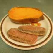 Fried Spam on plate with bread